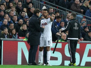 Tottenham Hotspur midfielder Mousa Dembele talks with manager Mauricio Pochettino on the touchline during his side's clash with Bayer Leverkusen at Wembley Stadium on November 2, 2016