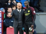 Pep Guardiola has a word with Yaya Toure during the Premier League game between Crystal Palace and Manchester City on November 19, 2016