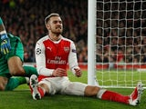 Aaron Ramsey takes a seat during the Champions League game between Arsenal and PSG on November 23, 2016