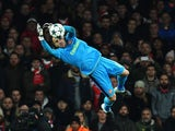 David Ospina makes a save during the Champions League game between Arsenal and PSG on November 23, 2016