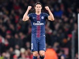 Edinson Cavani celebrates scoring during the Champions League game between Arsenal and PSG on November 23, 2016