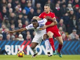 Jordan Henderson and Victor Anichebe in action during the Premier League game between Liverpool and Sunderland on November 26, 2016