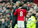 Manchester United midfielder Juan Mata is congratulated by manager Jose Mourinho during his side's Premier League clash with Arsenal at Old Trafford on November 19, 2016