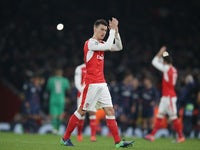 Laurent Koscielny reacts at the end of the Champions League game between Arsenal and PSG on November 23, 2016