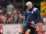 Stoke City manager Mark Hughes watches on during his side's Premier League clash with Bournemouth at the bet365 Stadium on November 19, 2016