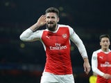 Olivier Giroud celebrates during the Champions League game between Arsenal and PSG on November 23, 2016