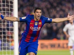 Luis Suarez celebrates scoring during the La Liga game between Barcelona and Real Madrid on December 3, 2016