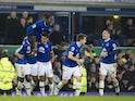 Ashley Williams celebrates with teammates after scoring during the Premier League game between Everton and Arsenal on December 13, 2016