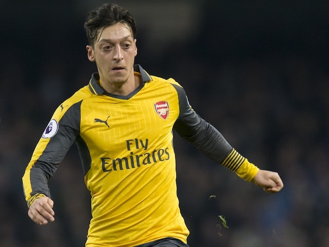 9fcdb9fa2 Henry tells Ozil   Stay and become a legend . © SilverHub. Arsenal legend  Thierry Henry wants midfield ace Mesut ...