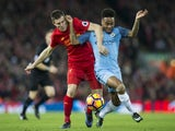 James Milner tussles with Raheem Sterling during the Premier League game between Liverpool and Manchester City on December 31, 2016