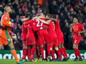 Liverpool move back up to second