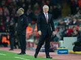 Stoke City manager Mark Hughes watches on during his side's Premier League clash with Liverpool at Anfield on December 27, 2016
