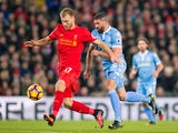 Liverpool defender Ragnar Klavan holds off the challenge of Stoke City's Jonathan Walters during the Premier League clash at Anfield on December 27, 2016