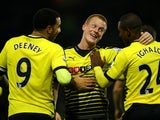Ben Watson celebrates with Troy Deeney and Odion Ighalo during the game between Watford and Man City on January 2, 2016