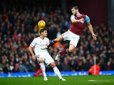 Dejan Lovren and big Andy Carroll in action during the game between West Ham and Liverpool on January 2, 2016
