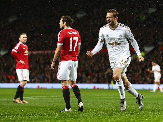 Gylfi Sigurdsson celebrates scoring during the game between Manchester United and Swansea on January 2, 2016