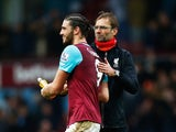 Jurgen Klopp congratulates Andy Carroll during the game between West Ham and Liverpool on January 2, 2016