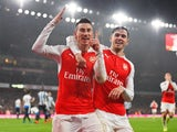 Laurent Koscielny celebrates with Aaron Ramsey during the game between Arsenal and Newcastle on January 2, 2016