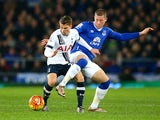 Ross Barkley gets his leg over Tom Carroll during the game between Everton and Tottenham Hotspur on January 3, 2016