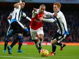 Theo Walcott and ginger Jack Colback in action during the game between Arsenal and Newcastle on January 2, 2016