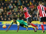 Victor Wanyama brings down Dieumerci Mbokani during the game between Norwich and Southampton on January 2, 2016