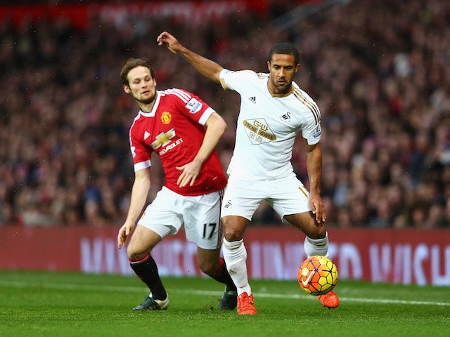 Wayne Routledge and Daley Blind in action during the game between Manchester United and Swansea on January 2, 2016