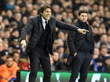 Antonio Conte shouts orders as Mauricio Pochettino watches on during the Premier League game between Tottenham Hotspur and Chelsea on January 4, 2017