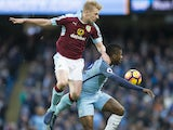 Ben Mee battles with Kelechi Iheanacho during the Premier League game between Manchester City and Burnley on January 2, 2017