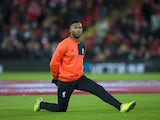 Daniel Sturridge warms up ahead of the Premier League game between Liverpool and Manchester City on December 31, 2016