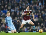 Kevin De Bruyne and George Boyd in action during the Premier League game between Manchester City and Burnley on January 2, 2017