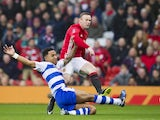 Wayne Rooney comes up against Liam Moore during the FA Cup game between Manchester United and Reading on January 7, 2017