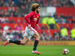 Fellaini not ready to quit United for China