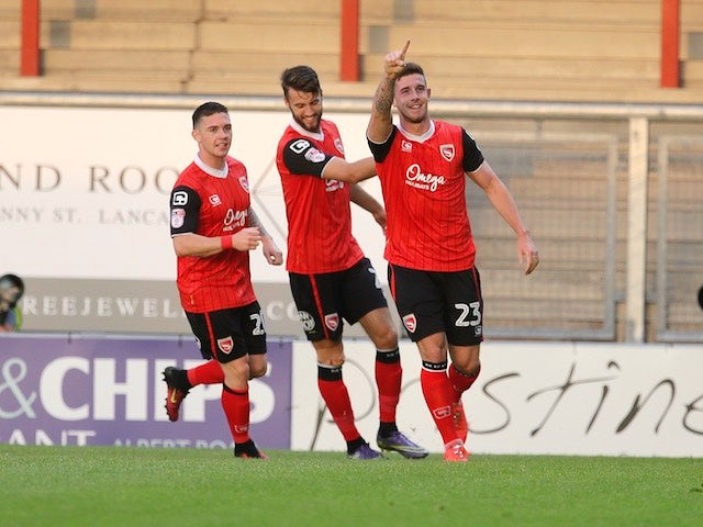 Cole Stockton celebrates scoring for Morecambe in August 2016