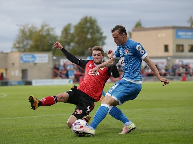 Tom Barkhuizen of Morecambe and Brad Smith of Bournemouth in action in August 2016