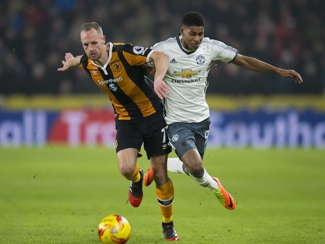 David Meyler and Marcus Rashford in action during the EFL Cup semi-final between Hull City and Manchester United on January 26, 2017
