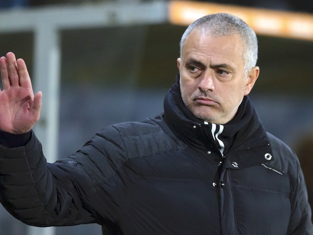 Jose Mourinho watches on during the EFL Cup semi-final between Hull City and Manchester United on January 26, 2017