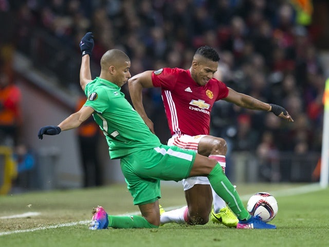 Manchester United's Antonio Valencia vies with Saint-Etienne's Kevin Monnet-Paquet in the Europa League on February 16, 2017