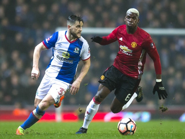 Manchester United's Paul Pogba and Blackburn Rovers' Craig Conway during the FA Cup fifth-round match on February 19, 2017