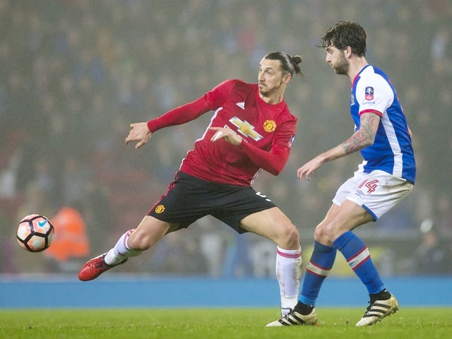 Manchester United's Zlatan Ibrahimovic and Blackburn Rovers' Charlie Mulgrew during the FA Cup fifth-round match on February 19, 2017