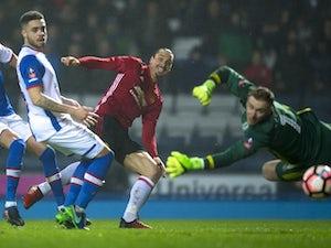 Man United fight back to see off Blackburn