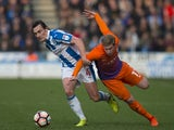Manchester City's Kevin De Bruyne and Huddersfield Town's Dean Whitehead during the FA Cup fifth-round match on February 18, 2017