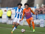 Manchester City's Leroy Sane and Huddersfield Town's Isaiah Brown on February 18, 2017