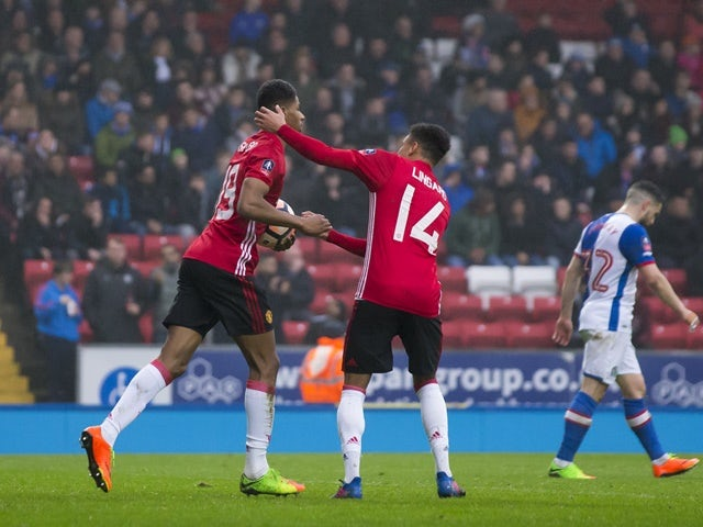 Manchester United's Marcus Rashford is congratulated by Jesse Lingard after scoring against Blackburn Rovers on February 19, 2017