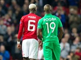 Manchester United midfielder Paul Pogba talks with brother and Saint-Etienne defender Florentin Pogba during the Europa League clash between the two sides at Old Trafford on February 16, 2017