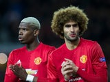 Manchester United midfielders Paul Pogba and Marouane Fellaini in action during the Europa League clash with Saint-Etienne at Old Trafford on February 16, 2017