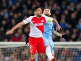 AS Monaco striker Radamel Falcao competes with Nicolas Otamendi in the Champions League last 16 first leg against Manchester City at the Etihad Stadium on February 21, 2017