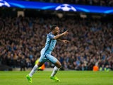 Manchester City winger Raheem Sterling wheels away in celebration after opening the scoring in the Champions League last 16 first leg against AS Monaco at the Etihad Stadium on February 21, 2017
