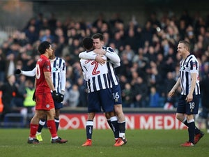Shaun Cummings celebrates scoring for Millwall against Leicester City on February 18, 2017