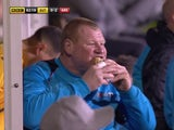 Wayne Shaw eats a pie during the FA Cup game between Sutton United and Arsenal on February 20, 2017