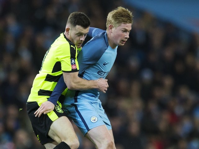 Harry Bunn gets to grips with Kevin De Bruyne during the FA Cup replay between Manchester City and Huddersfield Town on March 1, 2017